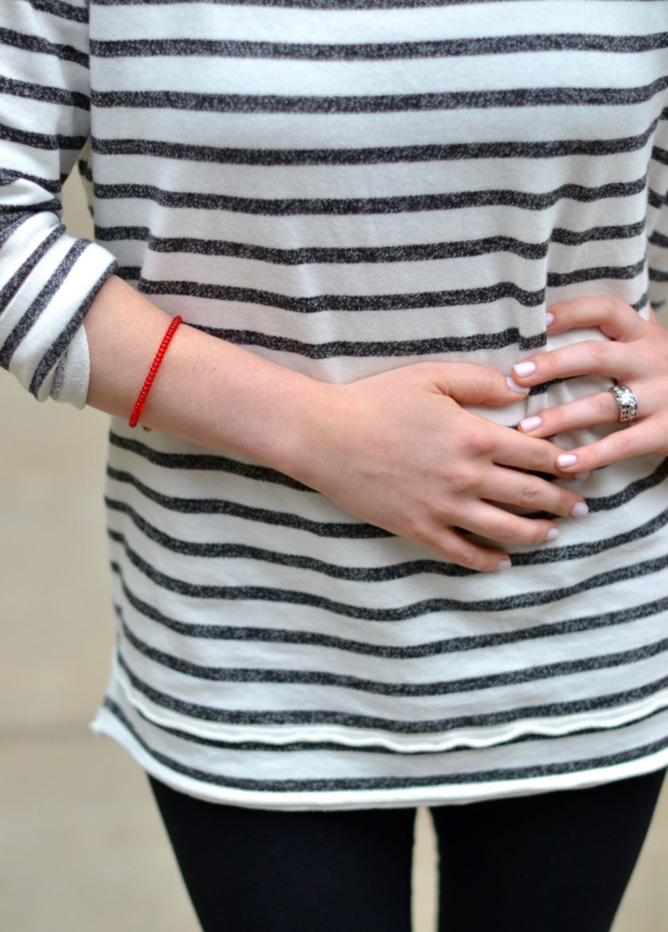 a black & white striped tunic + a pop of color with a bright red bracelet