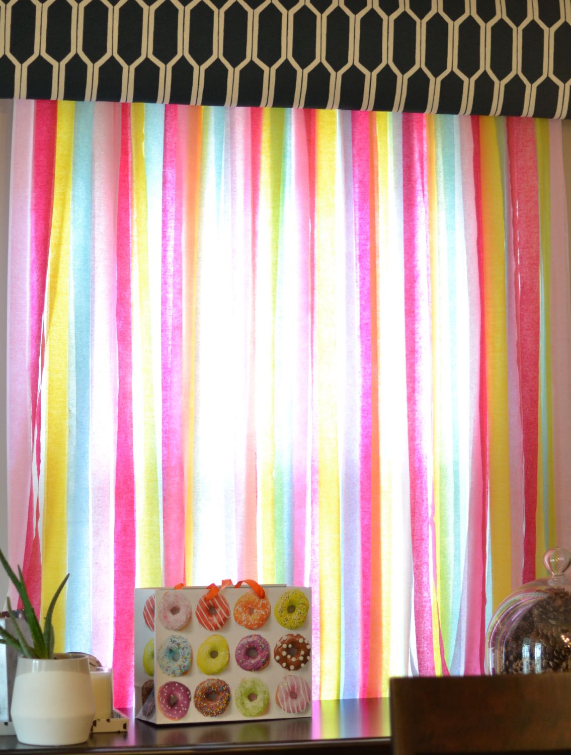 sprinkle colored crepe paper backdrop for a sprinkle birthday party // lovelyluckylife.com