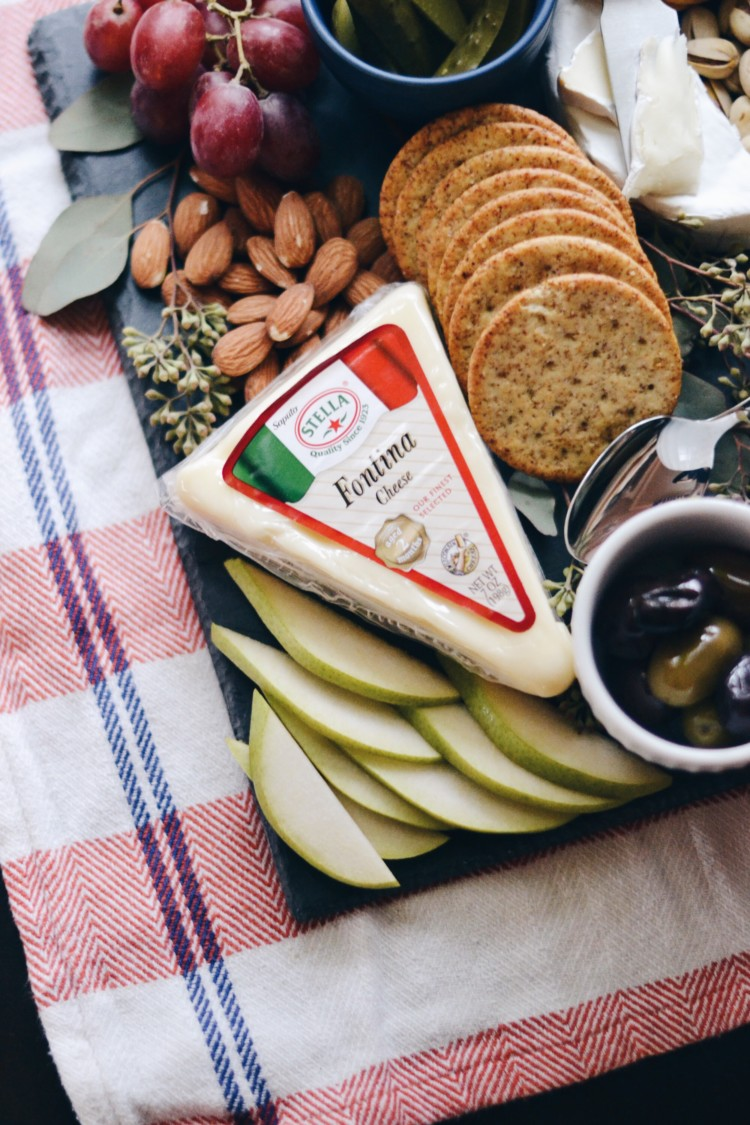 this cheese plate is so pretty and easy for a holiday party - cheese platter DIY