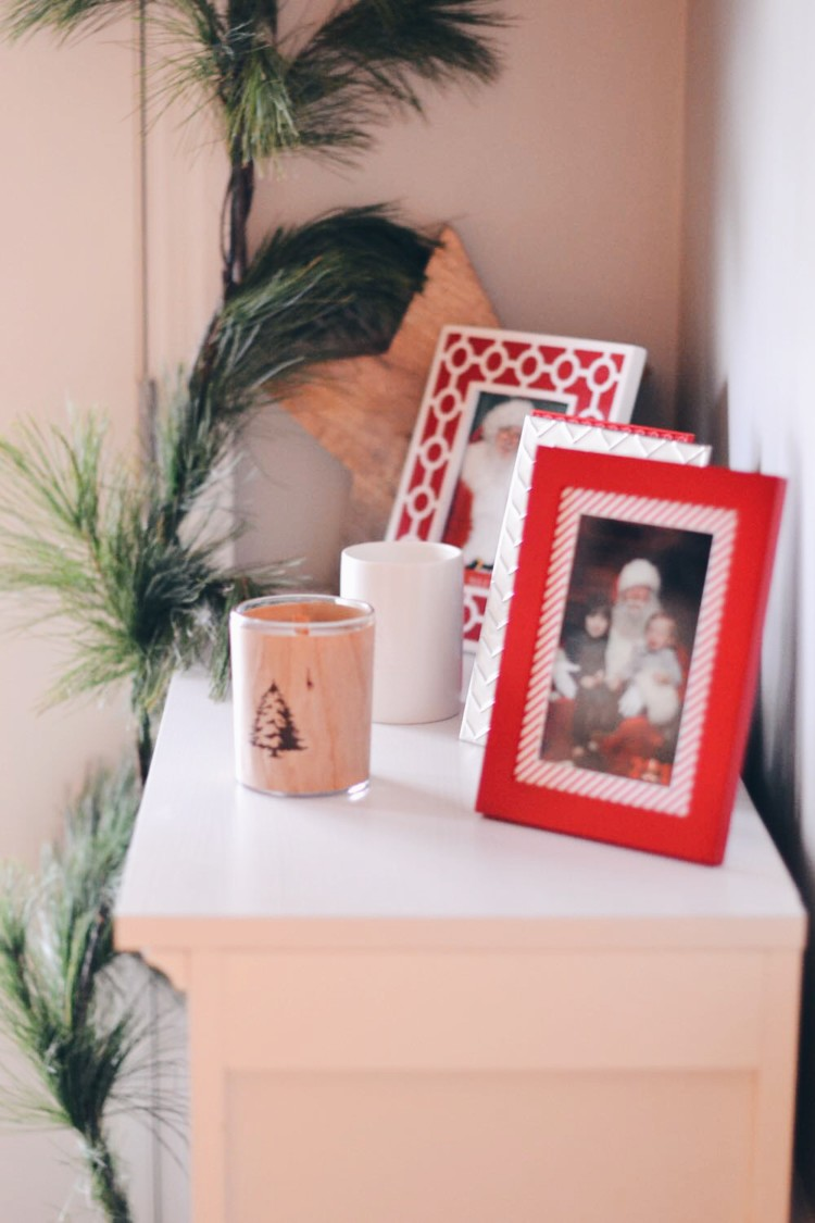 this is the cutest Christmas setup to display every year's Santa pictures