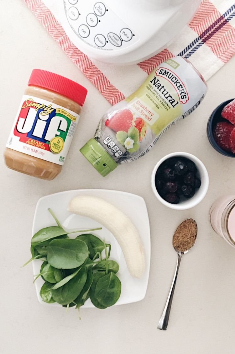 Smucker's Fruit Spread + Simply Jif Creamy Peanut Butter + a banana + a handful of spinach + frozen blueberries + frozen strawberries + fruit kefir = the perfect peanut butter & jelly smoothie! tastes just like a peanut butter and jelly sandwich but healthier