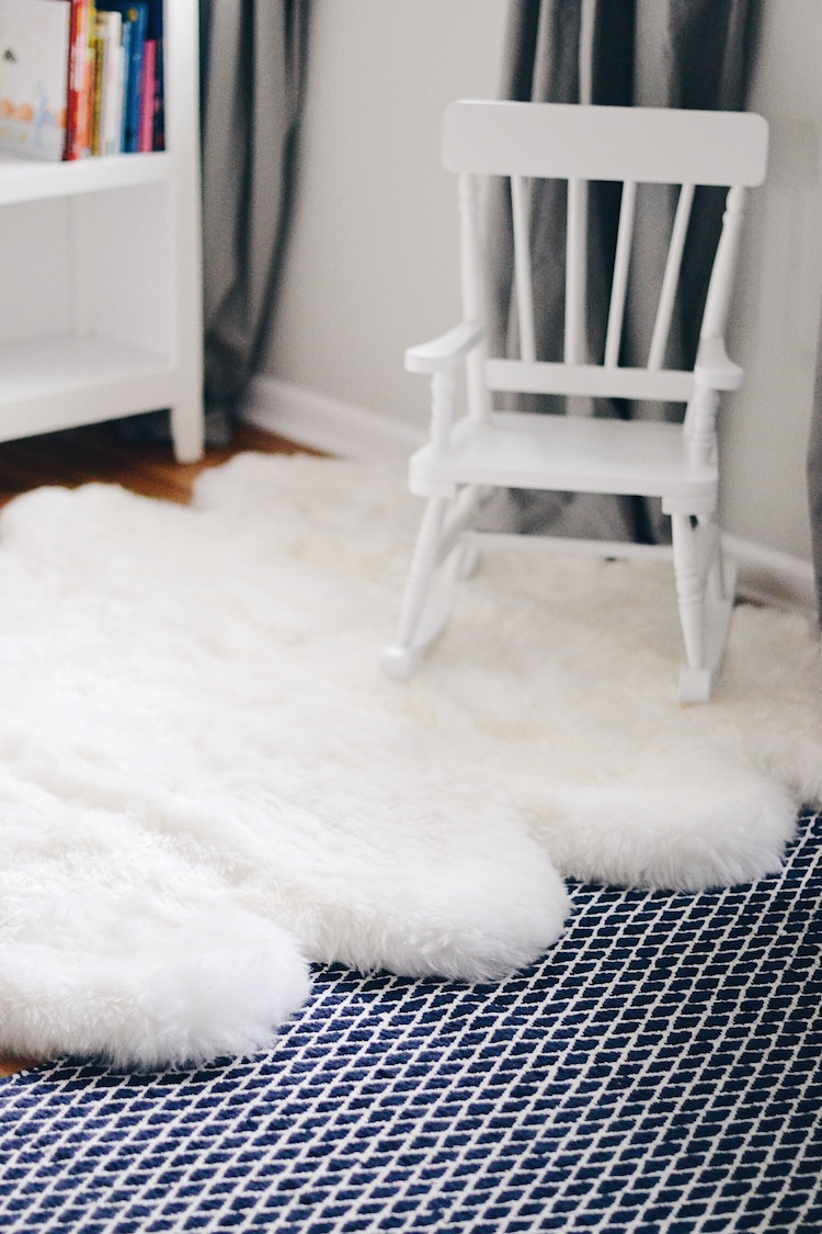 a must-have for a nursery or kid's room - fuzzy sheepskin rug and a white rockers for a fun little reading nook