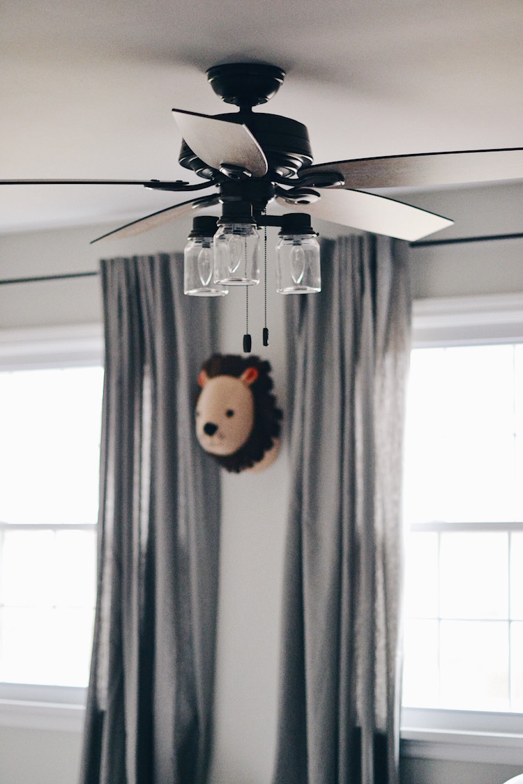 rustic inspired ceiling fan under $200 - love the lion head on the wall too