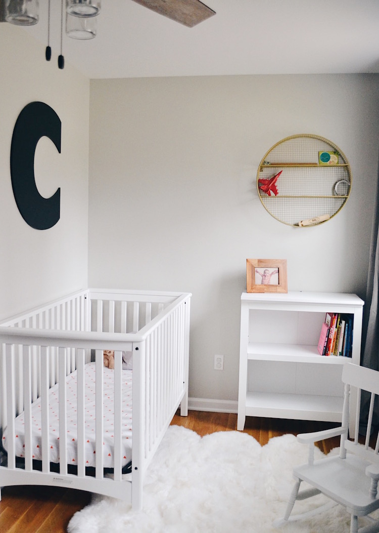 ideas for a boy room - love these boy room colors and wall art. giant initial wall art, white crib, faux fur rug and a little white bookshelf