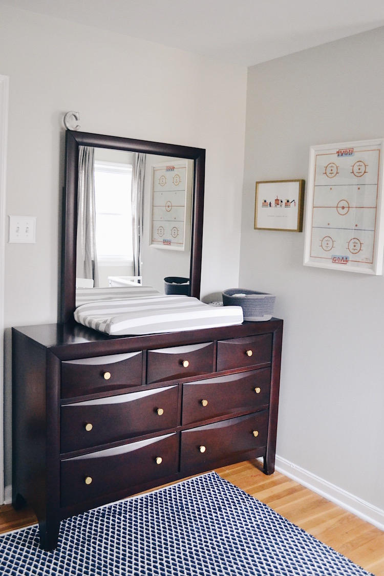 boy room decor & furniture - replaced the old silver knobs with gold knobs to give this old dresser a fresh feel. love the hockey print on the wall, too