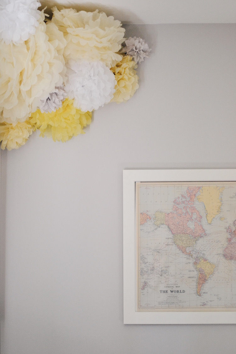 map and paper pom nursery decor. classic, gender neutral nursery - great for a boy nursery or girl nursery. greys, blues and a touch of soft yellow make this a great neutral baby room