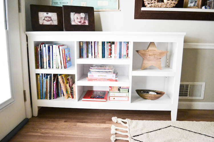 "our playroom den reveal - a shared space for the whole family. love this playroom design that doesn't scream ""toys!"". toy storage tips & tricks"