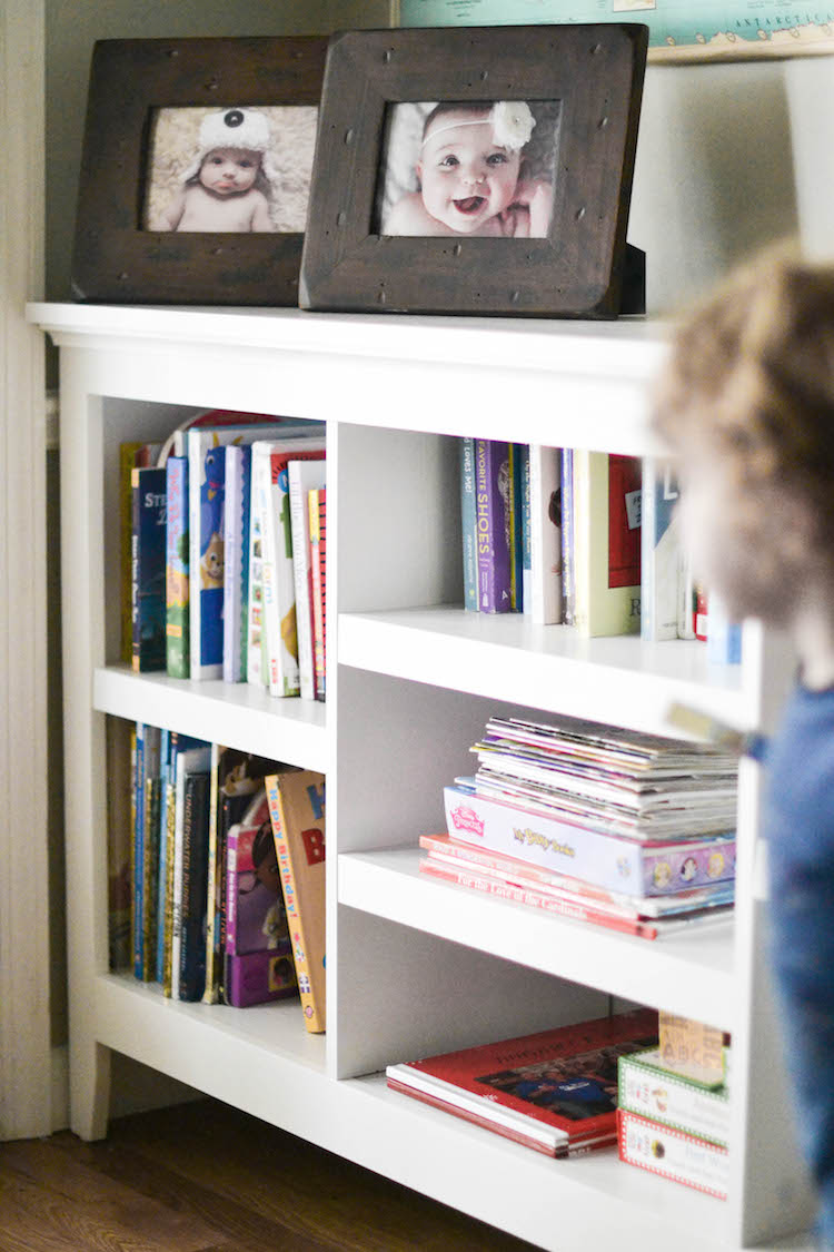 "our playroom den reveal - a shared space for the whole family. love this playroom design that doesn't scream ""toys!"". toy storage tips & tricks. a cute kids white bookshelf"