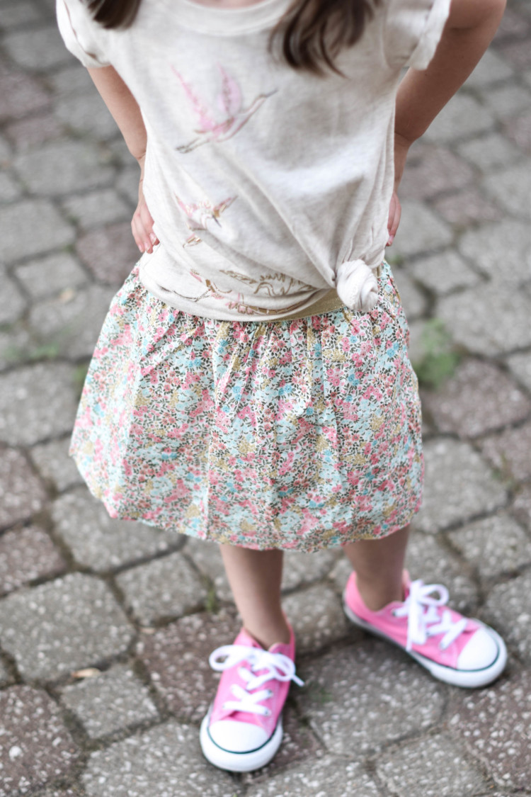 this side-tie shirt and floral skirt are the cutest for a little girl outfit