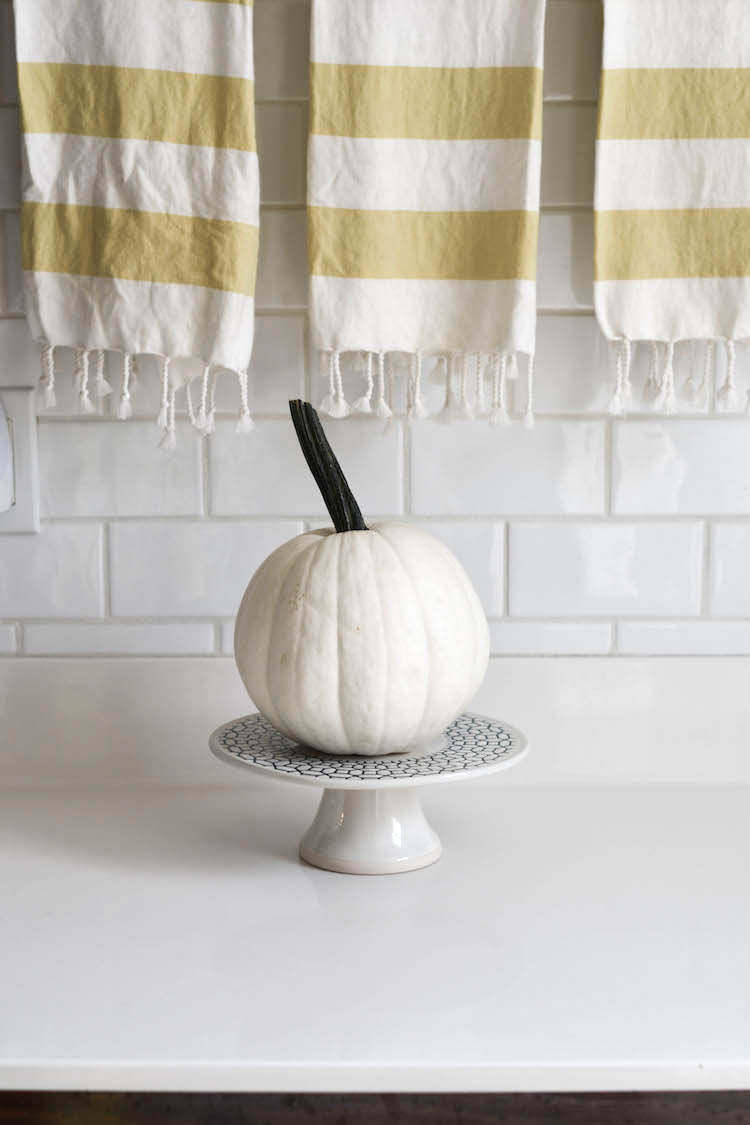 obsessed with this idea - simple white pumpkin on a basic cake stand - makes the pumpkin totally stand out