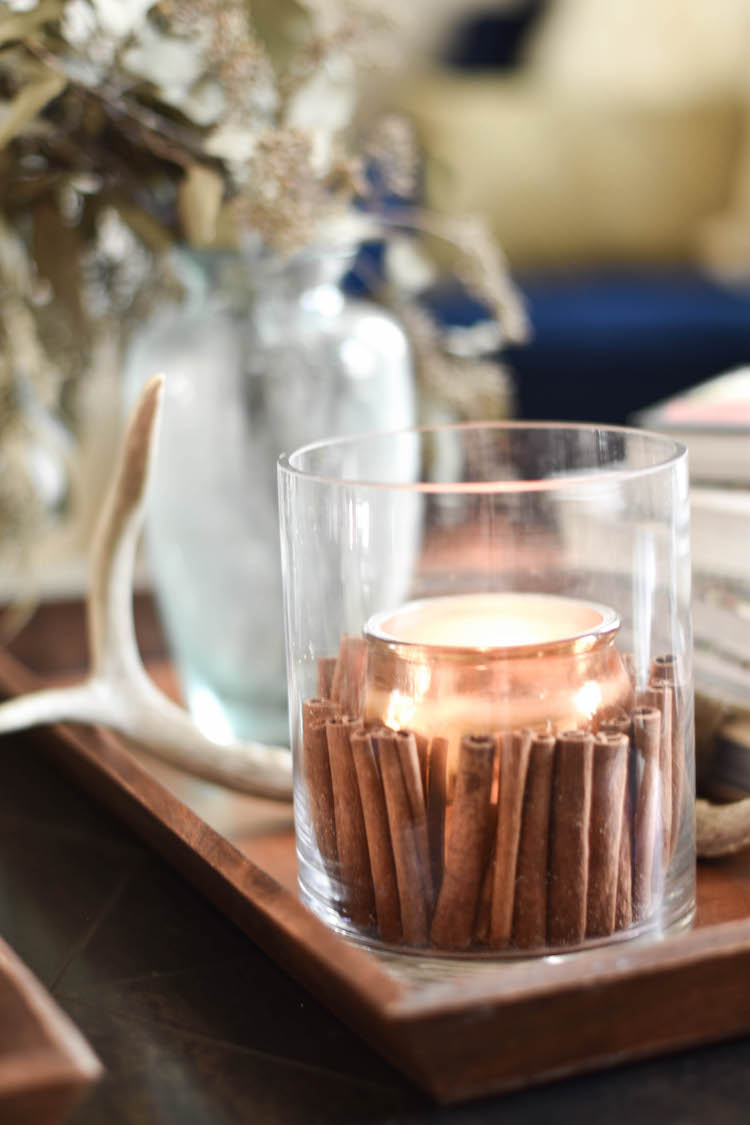 this cinnamon candle centerpiece makes the whole house smell like fall