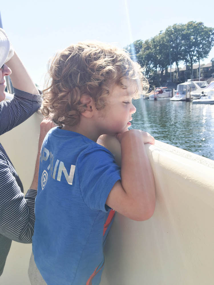 riding a boat - love his curly hair