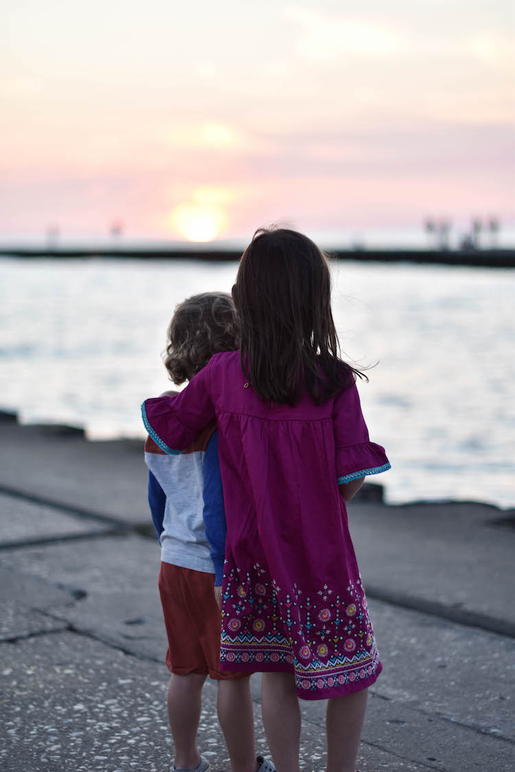 must-take shot on vacation in South Haven: a sunset picture on the pier - a family's guide to South Haven Michigan
