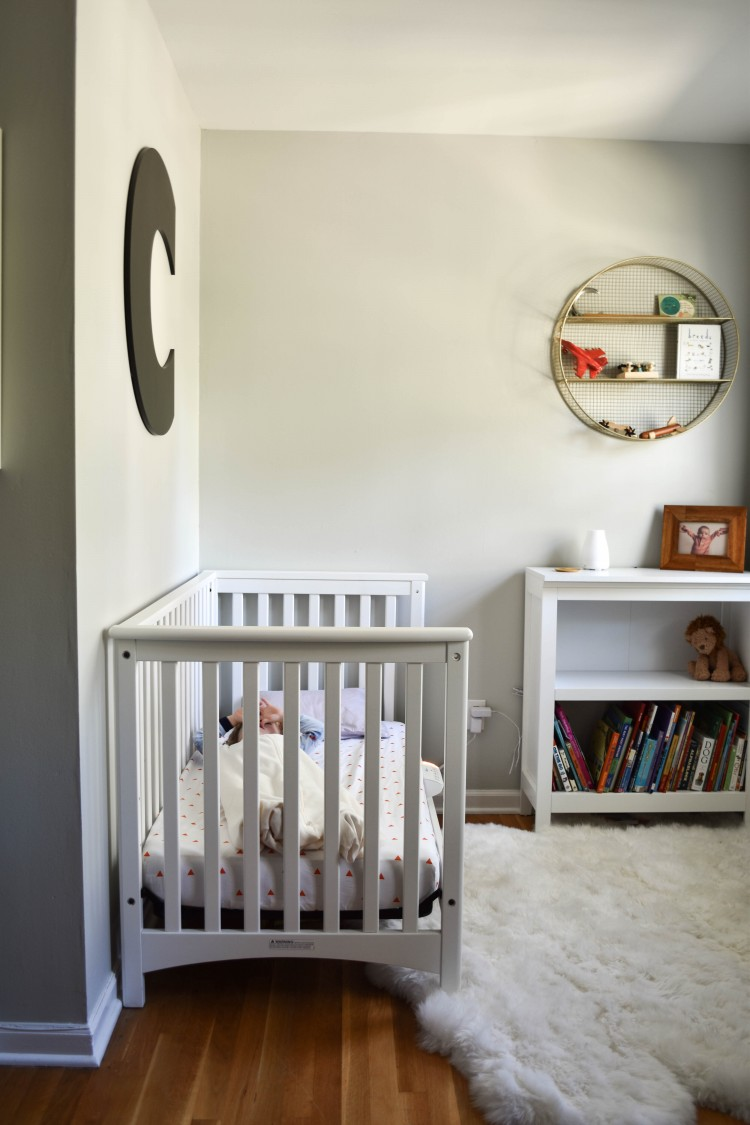 love this room for a toddler - neutral with pops of color + that white crib and fur rug are amazing