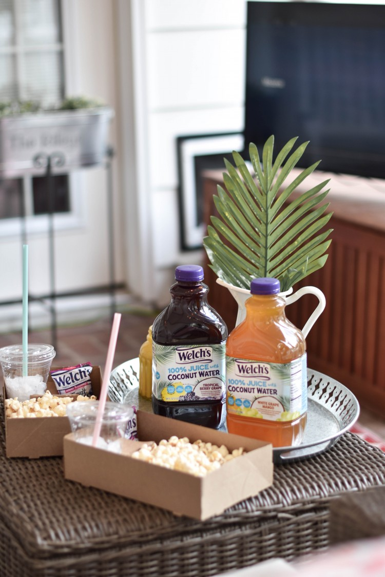 great luau party idea for kids! tropical themed movie night for kids - get popcorn boxes and fill them with snacks and juice for a movie-watching party