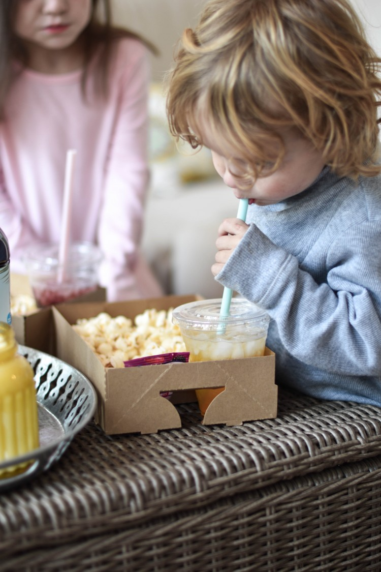 genius idea for watching movies with kids! put all their snacks into a little box so they aren't making a mess