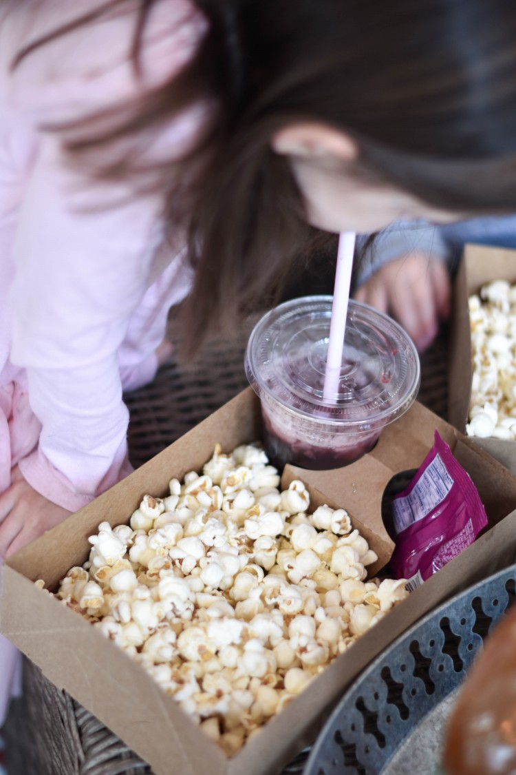 this little snack box is adorable for a movie party for kids! a cup of juice, a pack of fruitsnacks, and popcorn