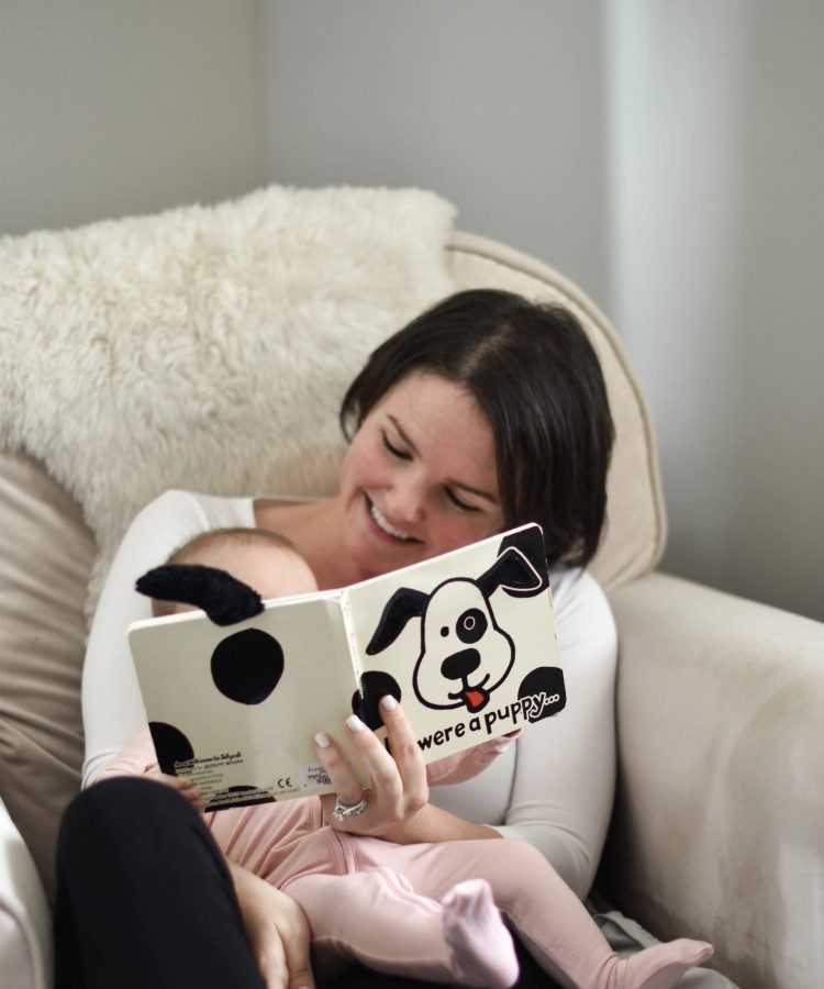 love this neutral nursery - IKEA sheepskin on the glider in the nursery makes it an extra cozy spot for reading to baby