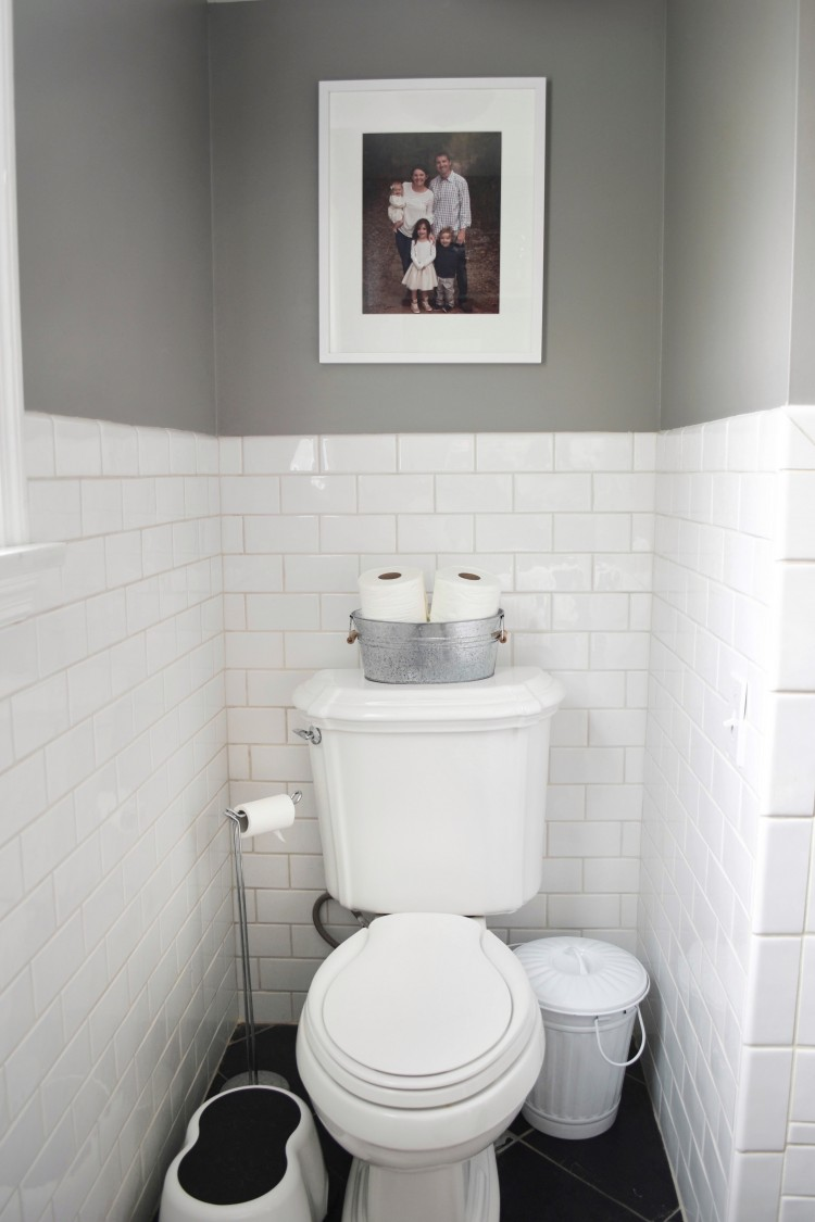 love this setup for the toilet in a kids' bathroom. toilet paper, extra wipes, a trashcan and a step stool