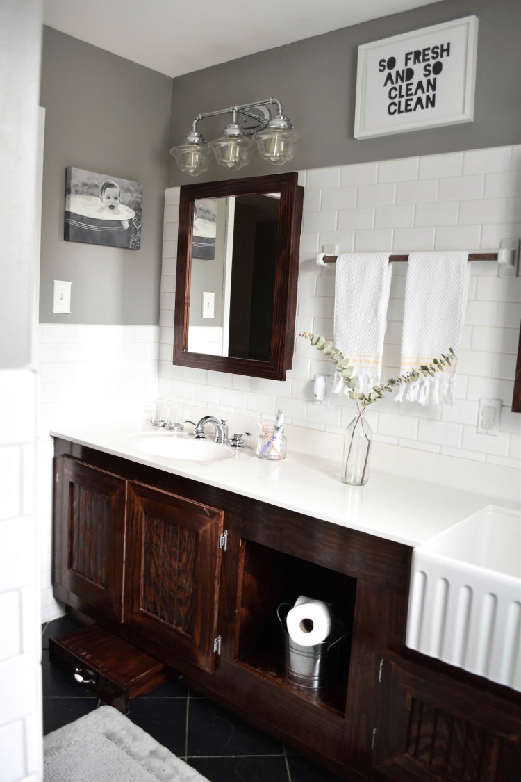 this kids' bathroom is sophisticated and modern and fresh - love all the white with the dark cabinets