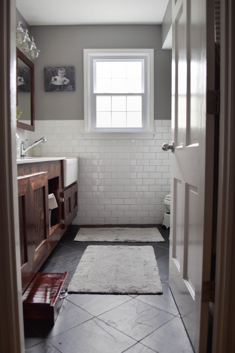 white subway tile on the walls + a white farmhouse sink - love this look for a kids' bathroom or hall bath