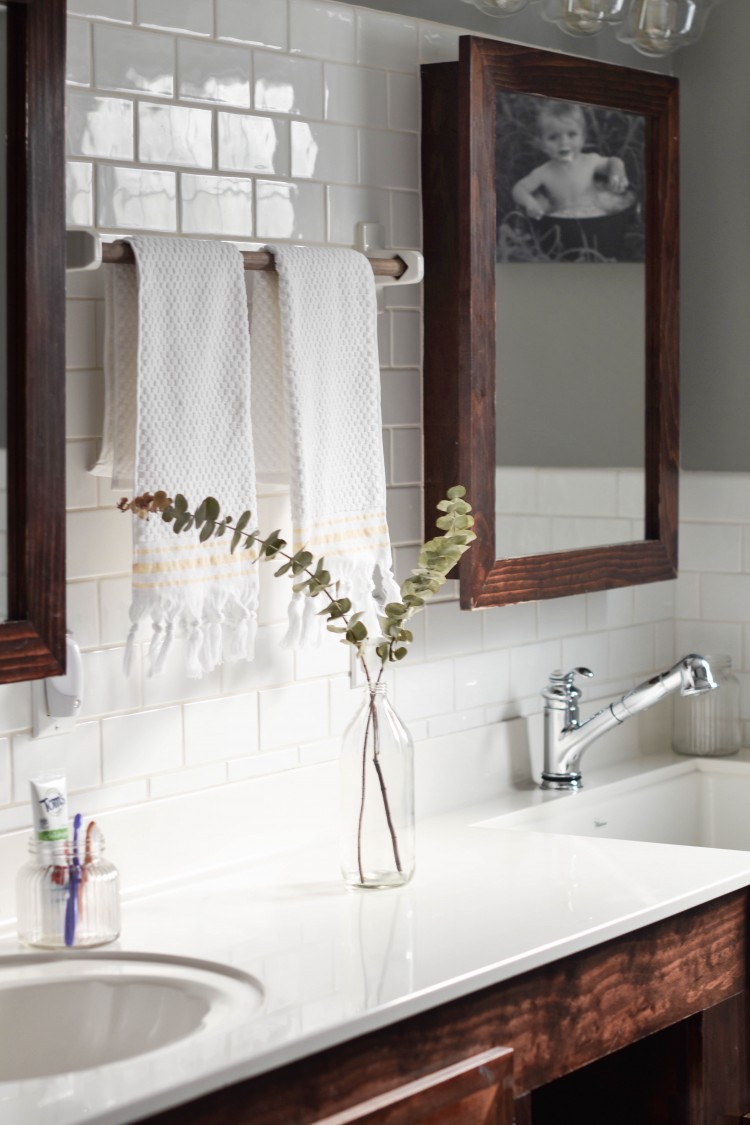 this white subway tile bathroom with grey walls is SO pretty and light! love the fresh eucalyptus