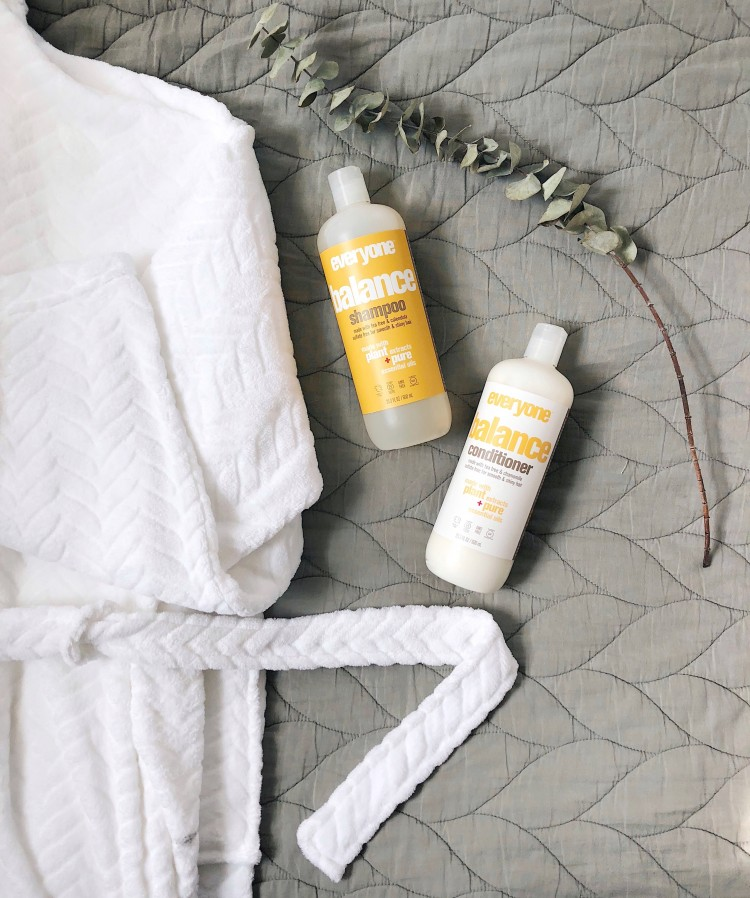 a cozy white robe, fresh eucalyptus, and Everyone products make for a zen shower