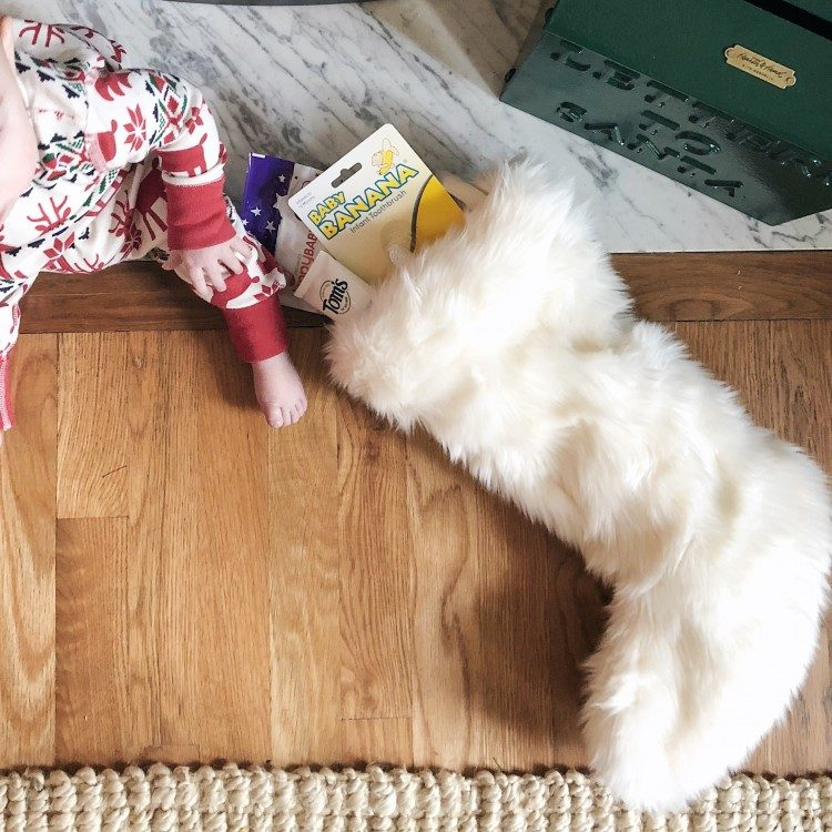white faux fur stocking for baby's first Christmas