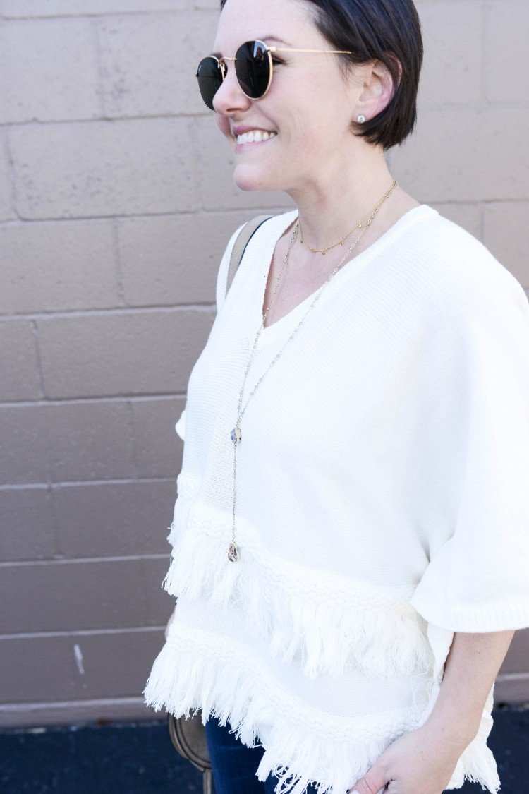 this white tassel poncho is adorable - love the lariat necklace too