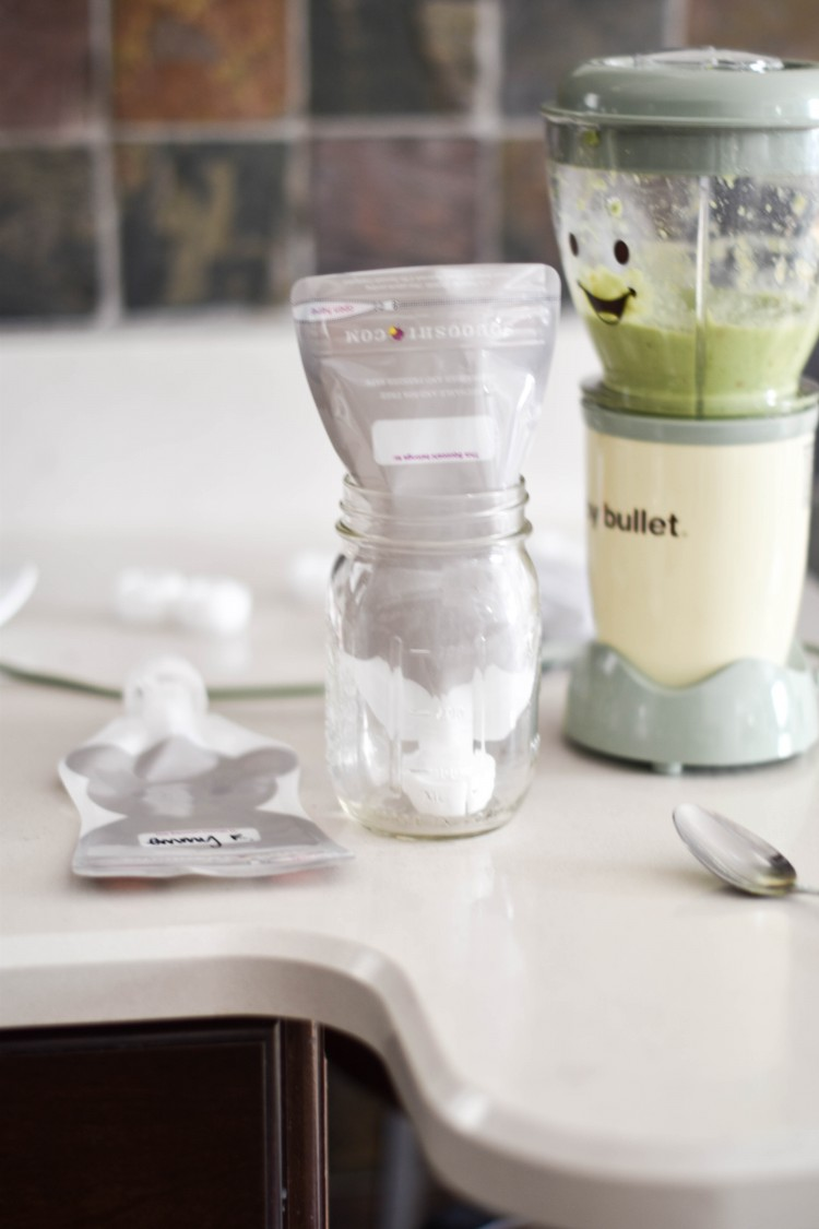how to fill reusable pouches with pureed food - the trick to getting all the baby food into the pouch is to use a cup to hold the pouch open. 2 amazing pouch recipes on the blog