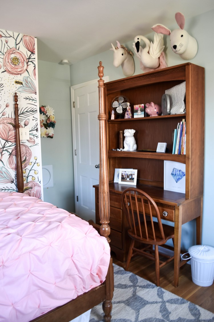 this desk space is SUPER cute for a little girl's room! love the stuffed animal heads on the wall