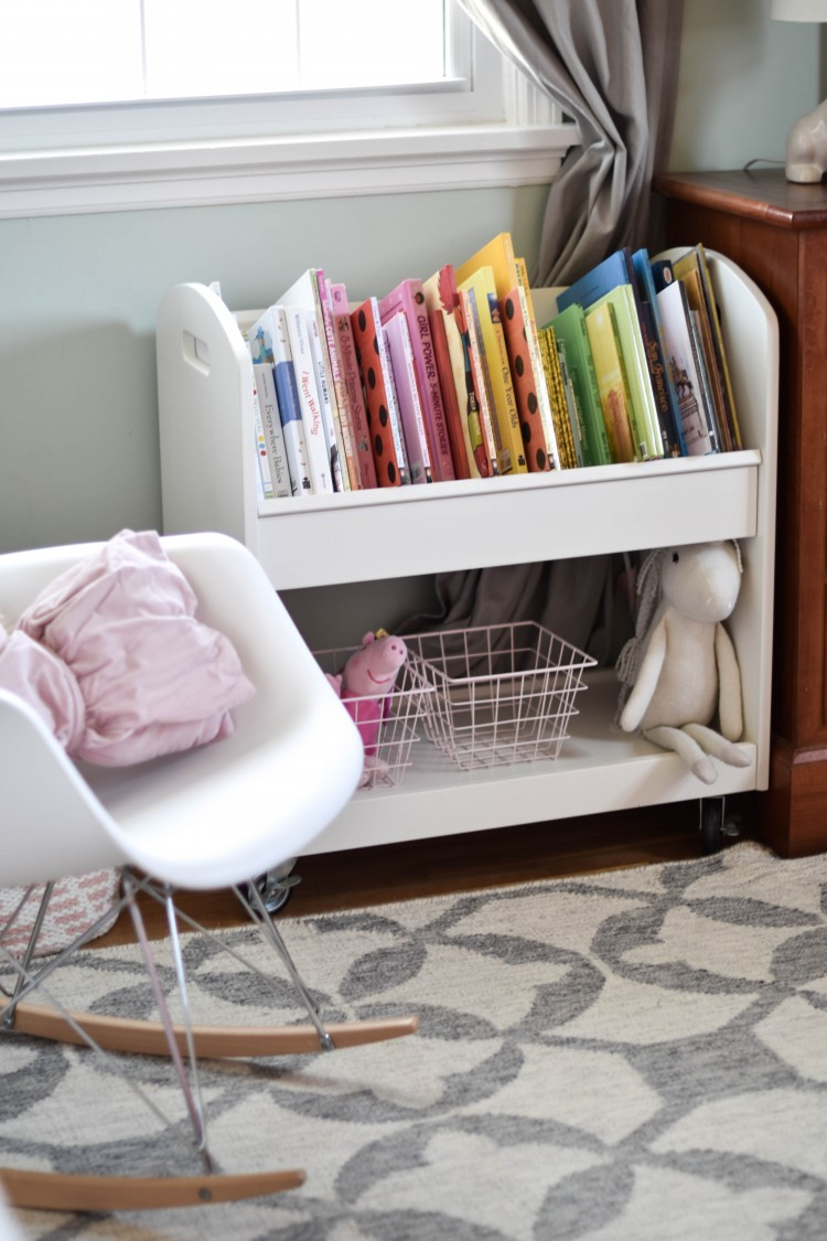 love this modern rocker (under $70!) and the cute white bookshelf in this girl room