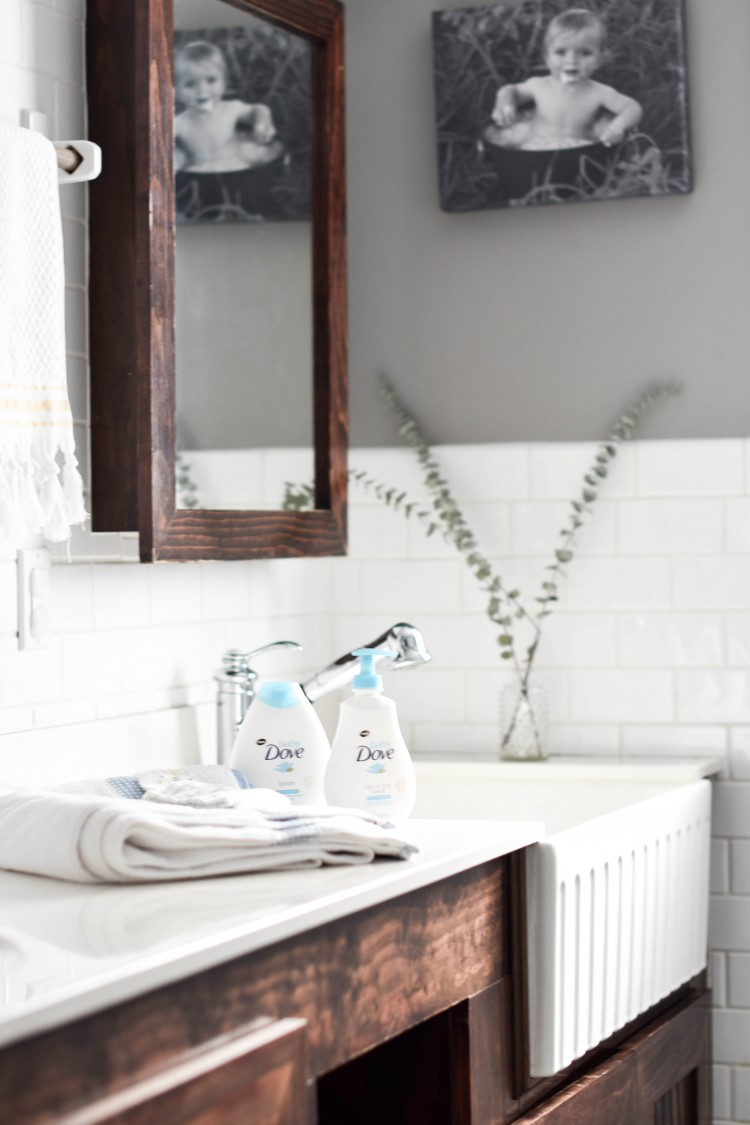loving the farmhouse sink in the bathroom - perfect for baby baths or rinsing laundry