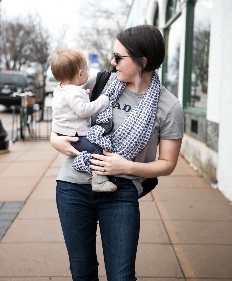 easy mom uniform - dark jeans, graphic tshirt, and a baby on the hip