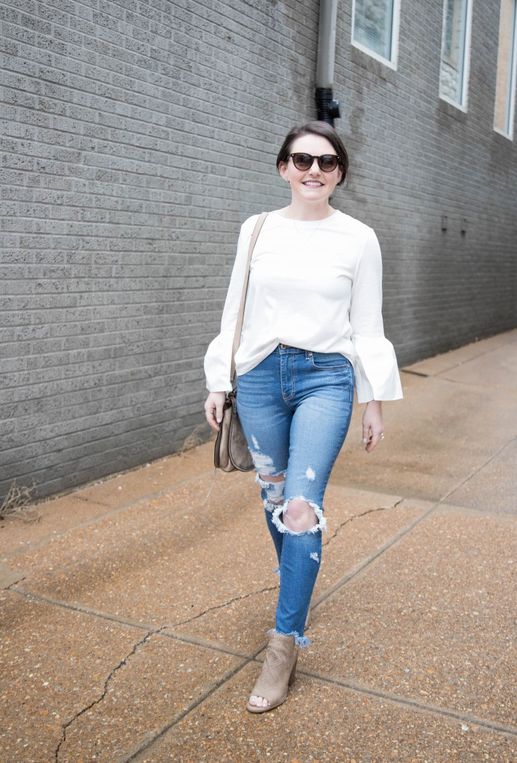 love this distressed jeans outfit for date night - white top with bell sleeves, distressed denim and neutral heels