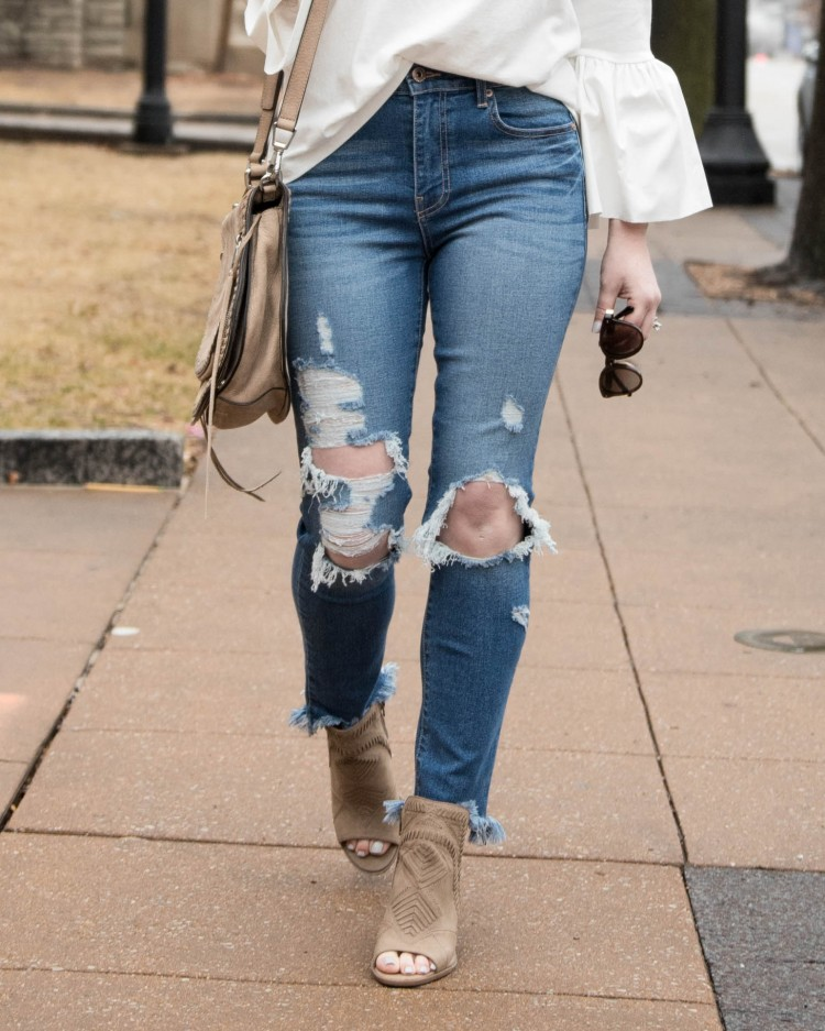 loving these distressed jeans with a high waist and destroyed hem - perfect distressed denim for spring
