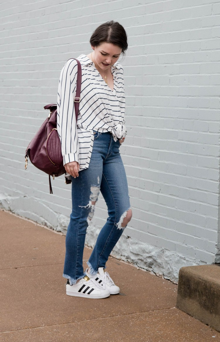such an easy casual distressed jeans outfit - striped shirt, backpack purse, adidas sneaks and the perfect pair of destroyed denim