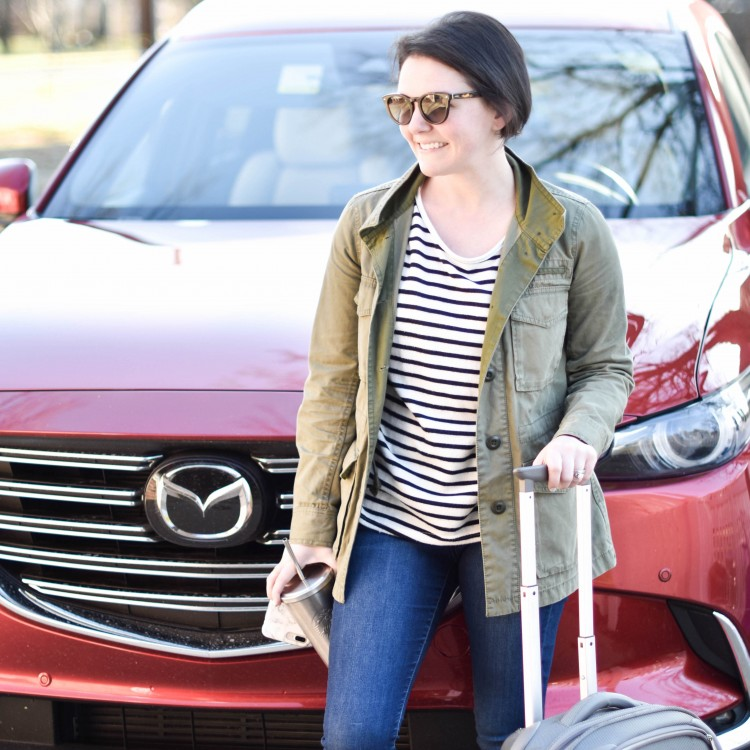 love this casual outfit for a road trip - striped tee, olive green jacket, dark jeans