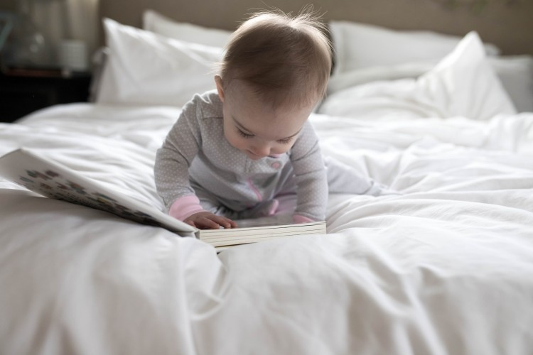 such a cute photo op for a baby - wearing pjs while reading a book. so sweet!