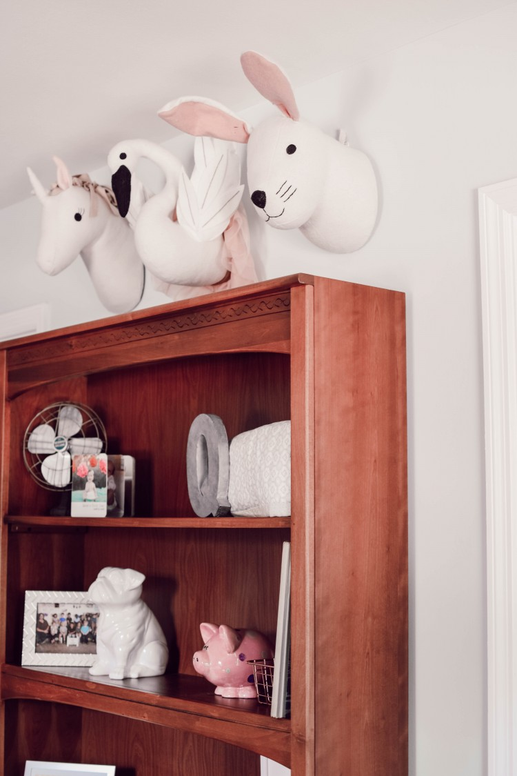these stuffed animal heads above a hutch are SO cute for this little girl's room #girlroom