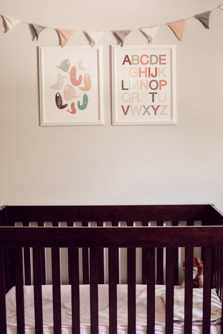 classic crib with wall art and bunting