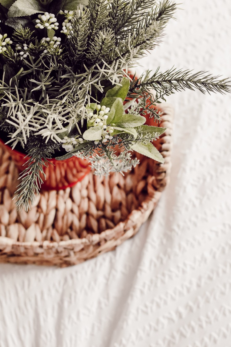decorating tip! put a faux christmas plant on the bed in a hyacinth tray