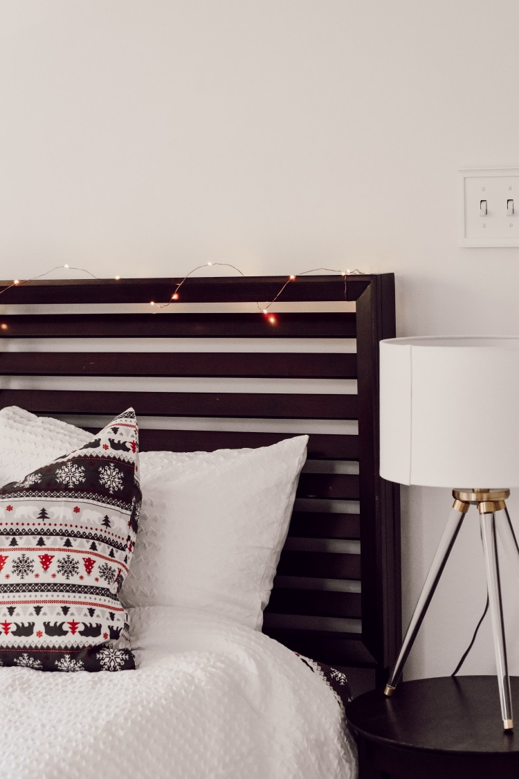 LED twinkle lights on bed frame for christmas - my favorite easy way to decorate for the holidays!
