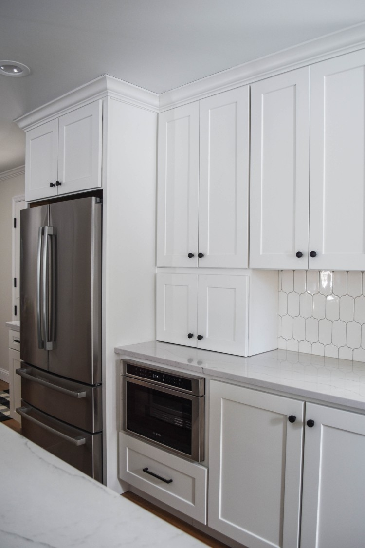 appliance garage in kitchen hides appliances like toasters and blenders on the counter
