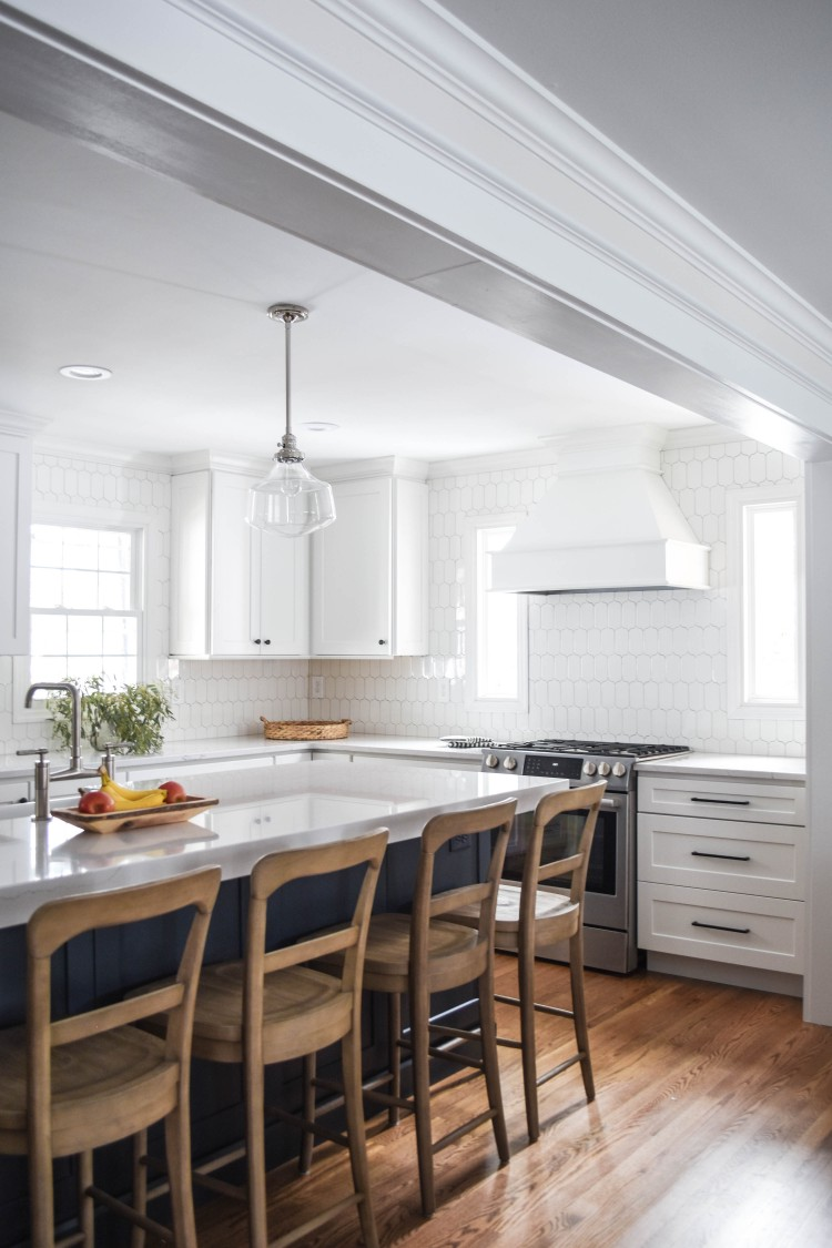love this classic yet modern farmhouse design for a kitchen. white cabinets, wood accents and stainless appliances