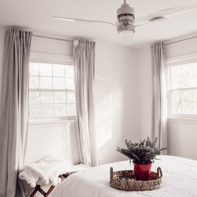 guest bedroom with white walls and white bedding