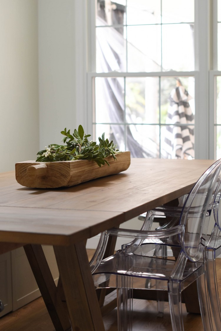 love this big modern farmhouse dining table with ghost casper acrylic chairs