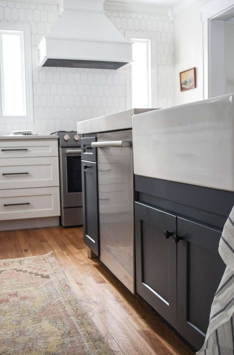 navy slate island color with an apron sink and a bosch dishwasher