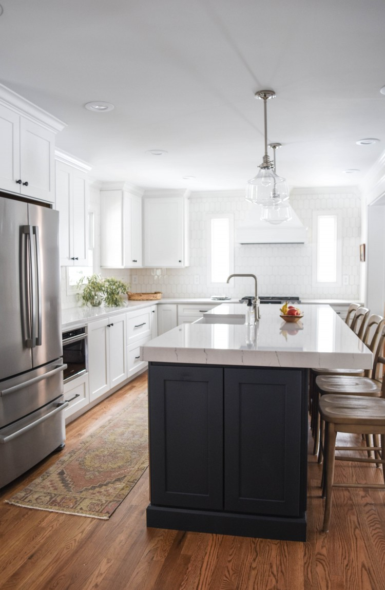 in love with this bright, light, airy white family kitchen