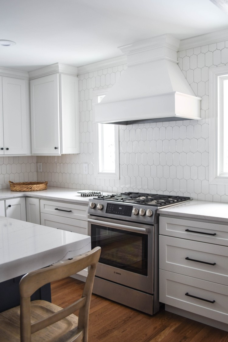 white range hood and white cabinets